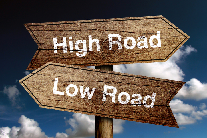 High Road And Low Road concept road sign with blue sky background